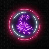 Scorpio glowing neon sign in circle frames on dark brick wall background.