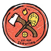 Scouting club emblem with crossed ax and nettle