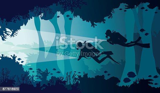 Scuba diver, lantern, coral reef, underwater cave and sea.