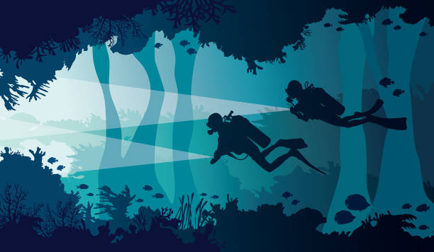Scuba diver, lantern, coral reef, underwater cave and sea. Silhouette of two scuba divers with lantern, coral reef with school of fish and underwater cave on a blue sea. Vector nature illustration. diving into water stock illustrations