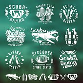 Scuba diving emblems and blurred background