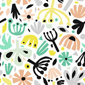 Seamless abstract background of black color with multicolored shaped figures that were cut out from real paper