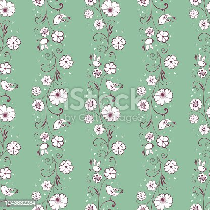 istock Seamless background with decorative blooming twigs and flying birds 1243832284