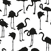 Seamless background with flamingos