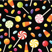 Vector seamless background with colorful Halloween candies on a black background.