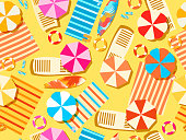 Seamless beach, top view. Chaise lounge with umbrella, surfboard, flip-flops and bedspreads. Beach vacation. Vector illustration