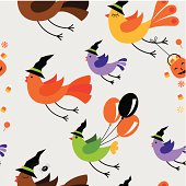 Seamless vector illustration of a family of birds flying to a Halloween party.