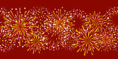 Seamless border with golden fireworks on red background for Christmas and New Year holiday design