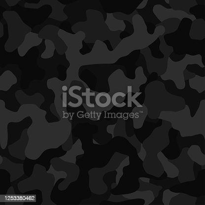 istock Seamless camouflage pattern. Black texture, vector illustration. Camo print background. Abstract military style backdrop 1253380462