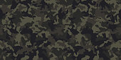istock Seamless camouflage pattern. Khaki texture, vector illustration. Camo print background. Abstract military style backdrop 1212864406