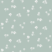 Seamless ditsy white floral pattern with tiny leaves hand drawn style. Cute small flowers repeat texture vector blue color.