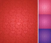 Seamlessly-repeating elegant valentine's day background with hearts and roses in several colors.