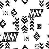 Tribal ethnic background. Stylish primitive geometric seamless pattern. Trendy grunge texture vector illustration. Monochrome ornament fabric textile.