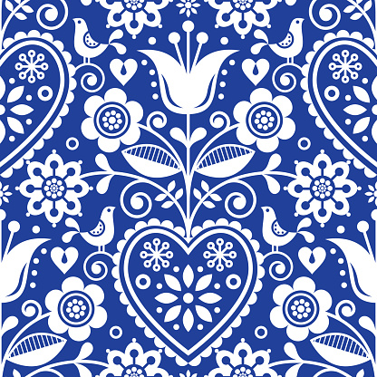 Seamless folk art vector pattern with birds and flowers, Scandinavian or Nordic floral design in white on navy blue background