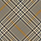 Seamless glen plaid pattern. Hounds tooth diagonal check plaid texture in black and gold for jacket, skirt, trousers, dress, or other modern autumn, winter, or spring tweed textile design.