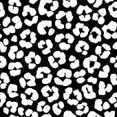 Seamless hand drawn ink splatter ornamental pattern leopard