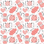 Seamless pattern with pink balls of yarn for knitting