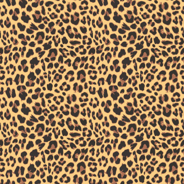 seamless leopard pattern background design - leopard texture stock illustrations, clip art, cartoons, & icons