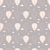 Seamless pattern childish drawing in pastel colors with asterisks, clouds and balloons