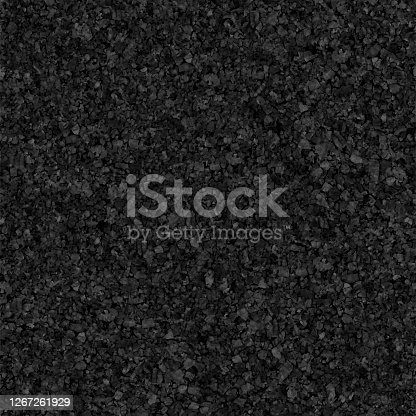 istock ROUGH BLACK STONE - seamless pattern design in vector with original natural harsh and uneven texture - porous structure resembling asphalt surface in macro - modern and original paper background 1267261929