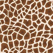 Seamless pattern. Imitation of skin of giraffe. Brown spots on beige background.