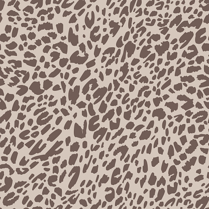 Seamless pattern made of leopard spots skin texture. African animal fur background. Spotted ornament. Vintage style. Good for wrapping, banner, fashion, textile and fabric.