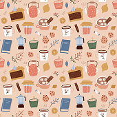 istock Seamless pattern of coffee, geyser coffee maker, sweeties, candles and plants on biege background. fall design of wrapping paper, wallpaper, textile design. Flat hand drawn repeating illustration. 1329903844
