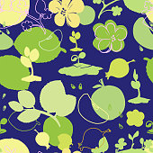 Seamless pattern symbolizing summer: sprouts, flowers, fruit and leaves on a blue background in shades of green