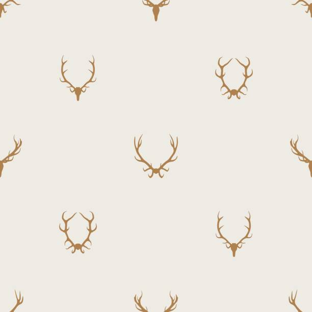 seamless pattern vector minimalist background with deer antlers - deer antlers stock illustrations, clip art, cartoons, & icons