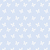 Seamless pattern vector of Tiny butterfly on pastel blue spot background.