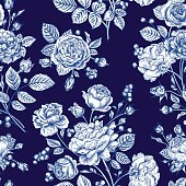 Beautiful seamless rose pattern on a blue background. Vector illustration.