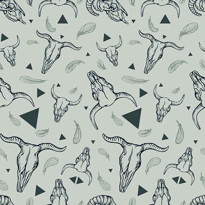 Seamless pattern with animals skulls, feathers and triangles.