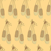 Seamless vector pattern with bast shoes. Can be used for graphic design, textile design or web design.