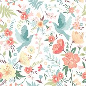 Cute vector seamless pattern with birds and flowers in pastel colors.
