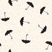 Seamless pattern with black umbrellas on light background with rain