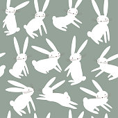 Seamless pattern with cartoon cute white rabbits. Animal pattern. Easter bunnies vector background.