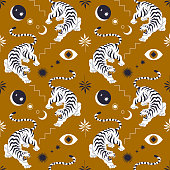 istock Seamless pattern with chinese tiger in boho asian style. Beautiful animal print design. For fabric, wall art, interior, packaging. Floral branch, crescent moon, star, eye. Magic mystery concept. 1220771942