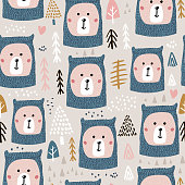 Seamless pattern with cute bear faces in knitted hat and woodland elements.Perfect for festive winter fabric,textile.Vector background