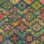 Seamless pattern with decorative mandalas. Vintage mandala elements. Colorful patchwork