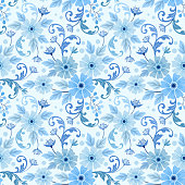 Seamless pattern with flowers and leaves on a blue background.