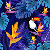 Seamless blue pattern with tropical flowers and toucan bird. Vector illustration.