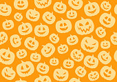 Seamless pattern with funny silhouettes of pumpkins. Vector.