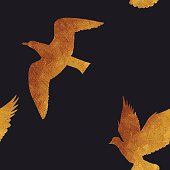 Seamless pattern with golden birds.