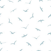 Seamless pattern with gulls on white background. Can be used for graphic design, textile design or web design.