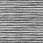 Seamless pattern with hand drawn brush stripes in black and white