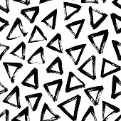 Seamless pattern with hand drawn triangles.