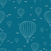 Seamless pattern with hot air balloons and seagull .