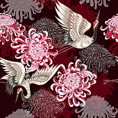Seamless pattern with Japanese white cranes and chrysanthemums on a claret background
