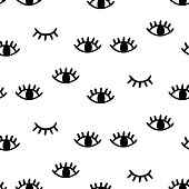 Vector hand drawn seamless pattern with open and winking eyes isolated on white