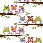 Seamless pattern with owls in the trees